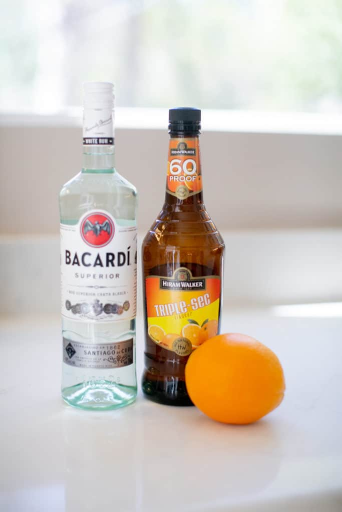 An image of Bacardi rum, orange liqueur, and an orange