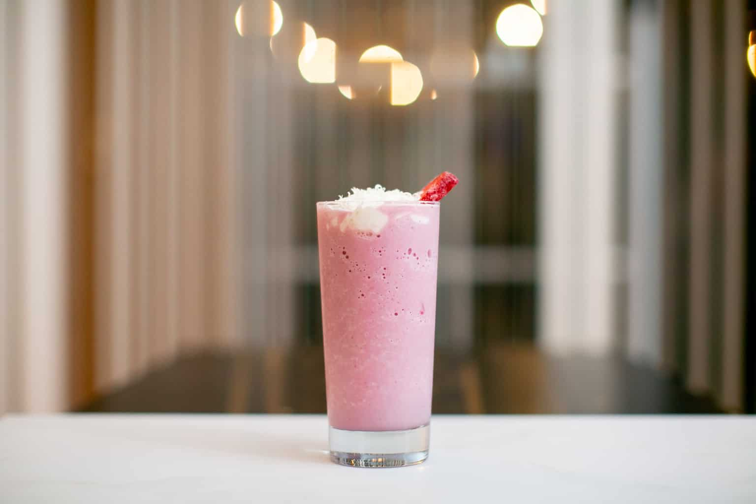 Strawberry milkshake topped with whipped cream