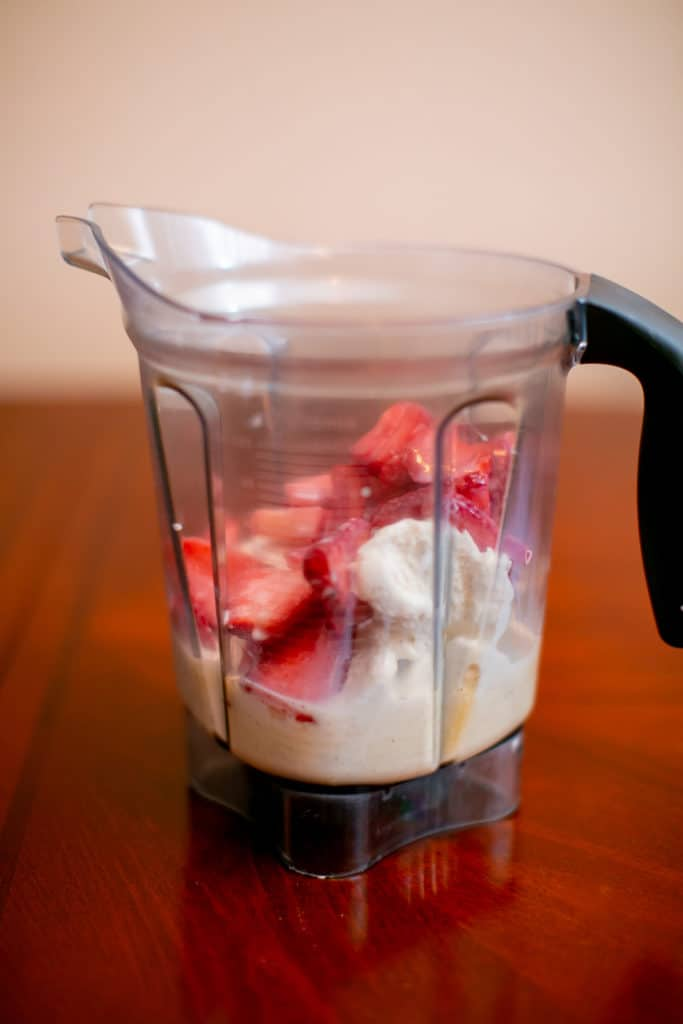 Blender of strawberries and ice cream