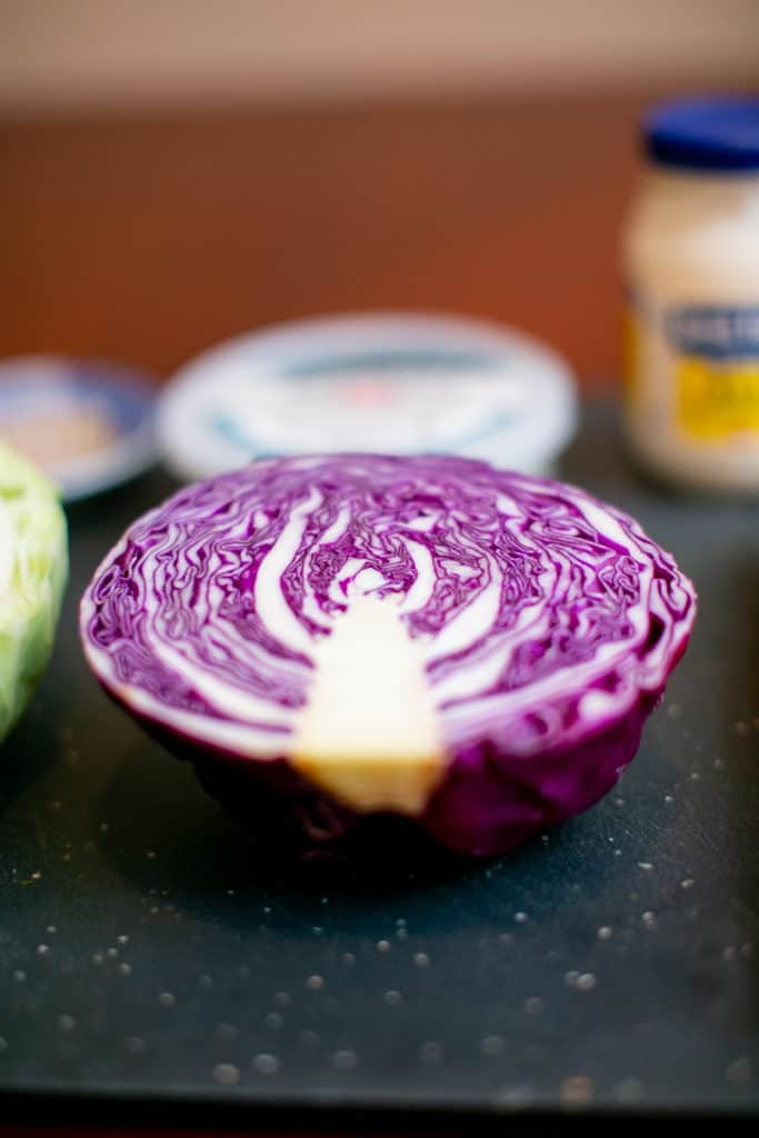 Red cabbage on a black cutting board