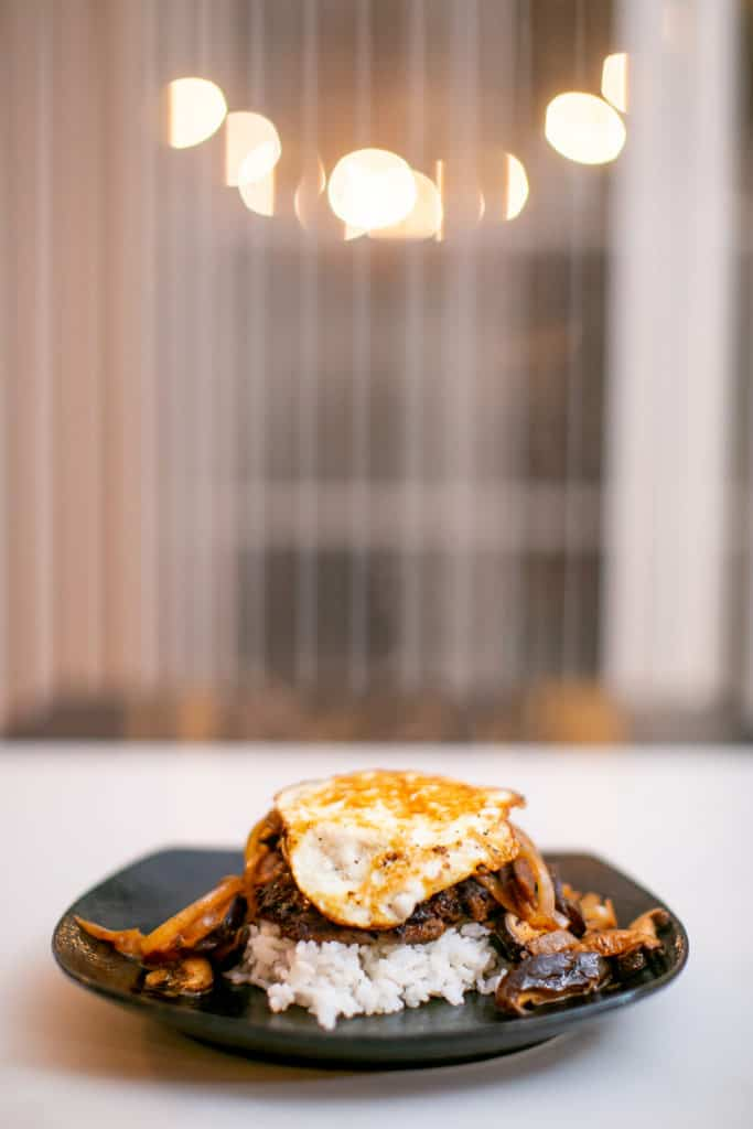 Chopped steak served over rice and topped with a cooked egg