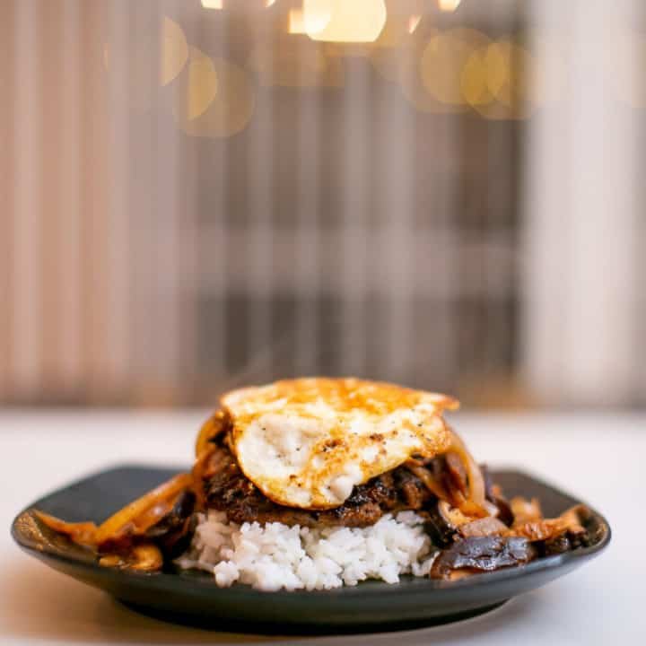 Chopped steak served with rice and egg