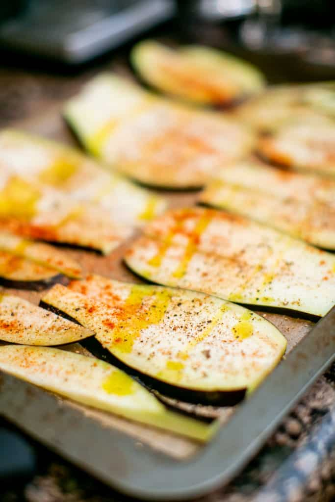 Aubergine eggplants thinly sliced and seasoned with paprika and olive oil
