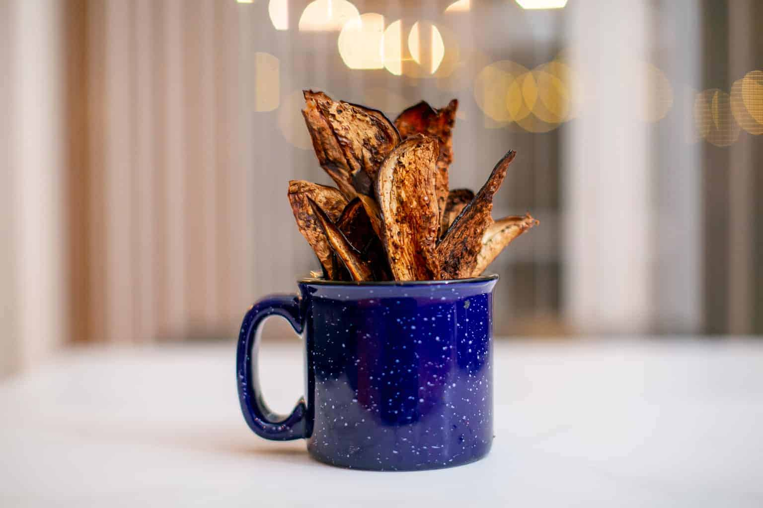 Crispy eggplant chips served in a mug