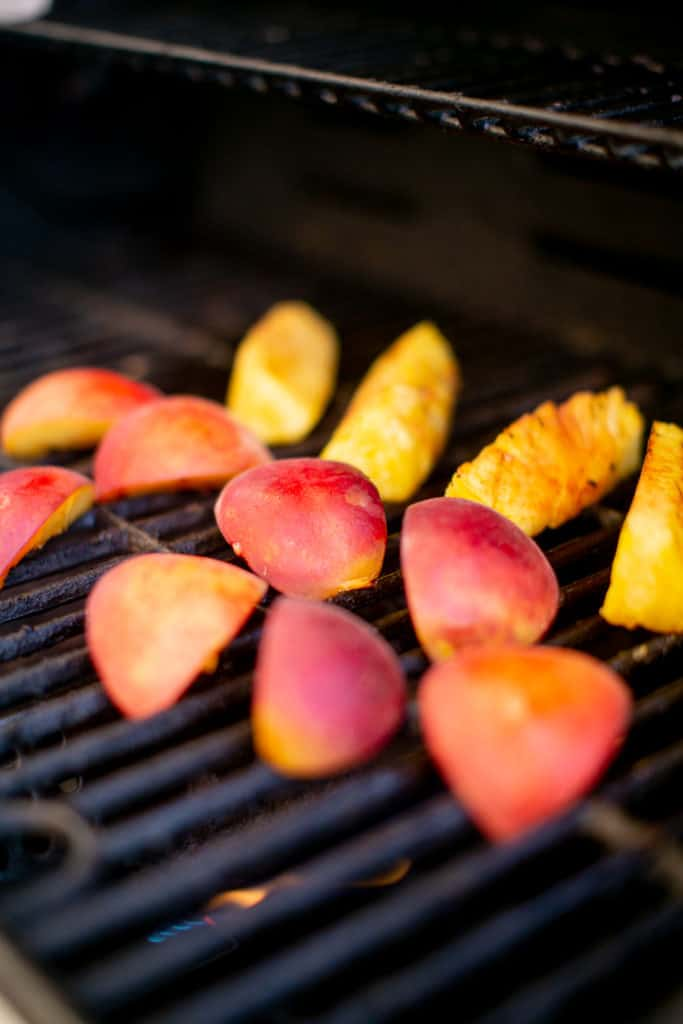 Outdoor grilling peaches and pineapples