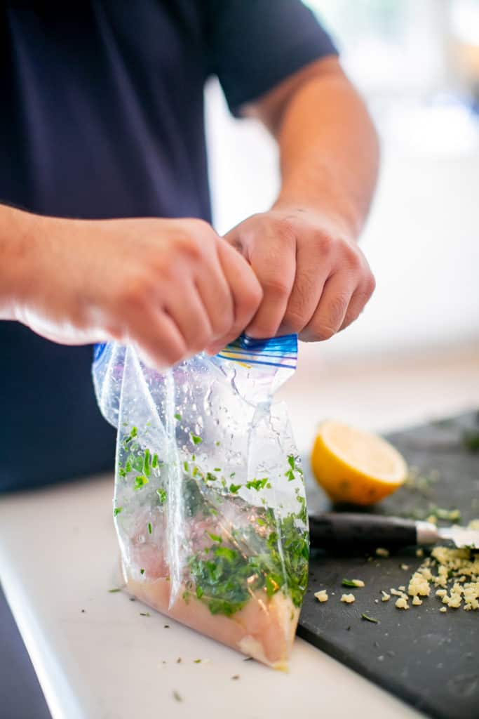 Mixing all ingredients in a Ziploc bag before submerging to a sous vide container