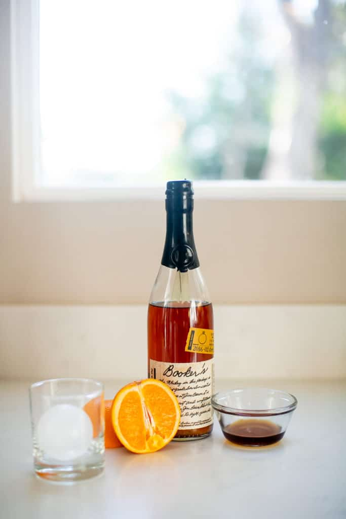 Ingredients for bourbon cocktail drink prepped on a table