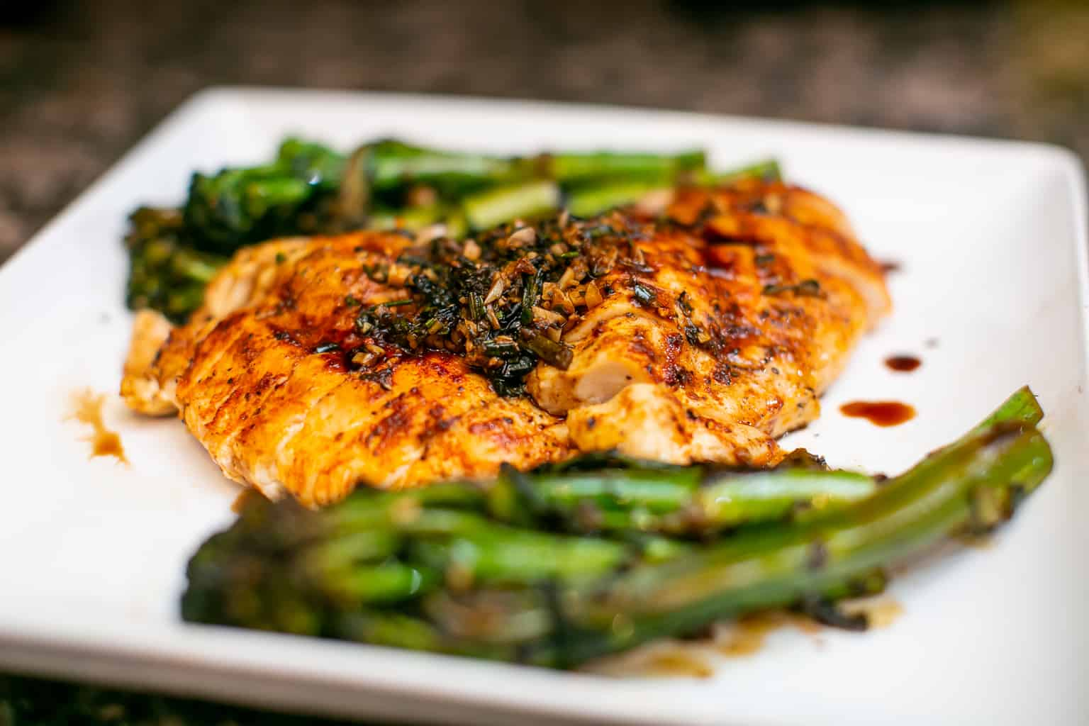 Close up of oven baked chicken breast with asparagus