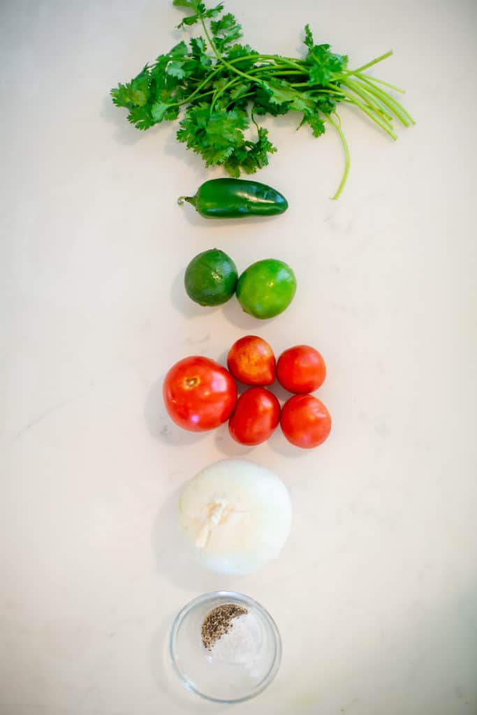 Ingredients needed to make a spicy pico de gallo