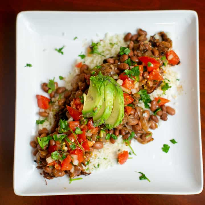 Pinto beans and chili lime rice topped with avocado