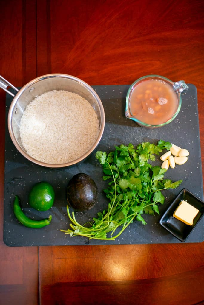 Prepping the ingredients for a pinto beans and chile lime rice recipe
