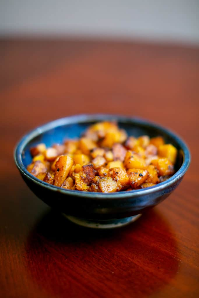 Close photo of roasted butternut squash served on a bowl