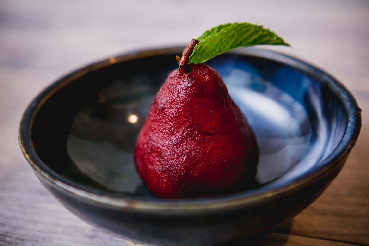 Poached pear in a bowl