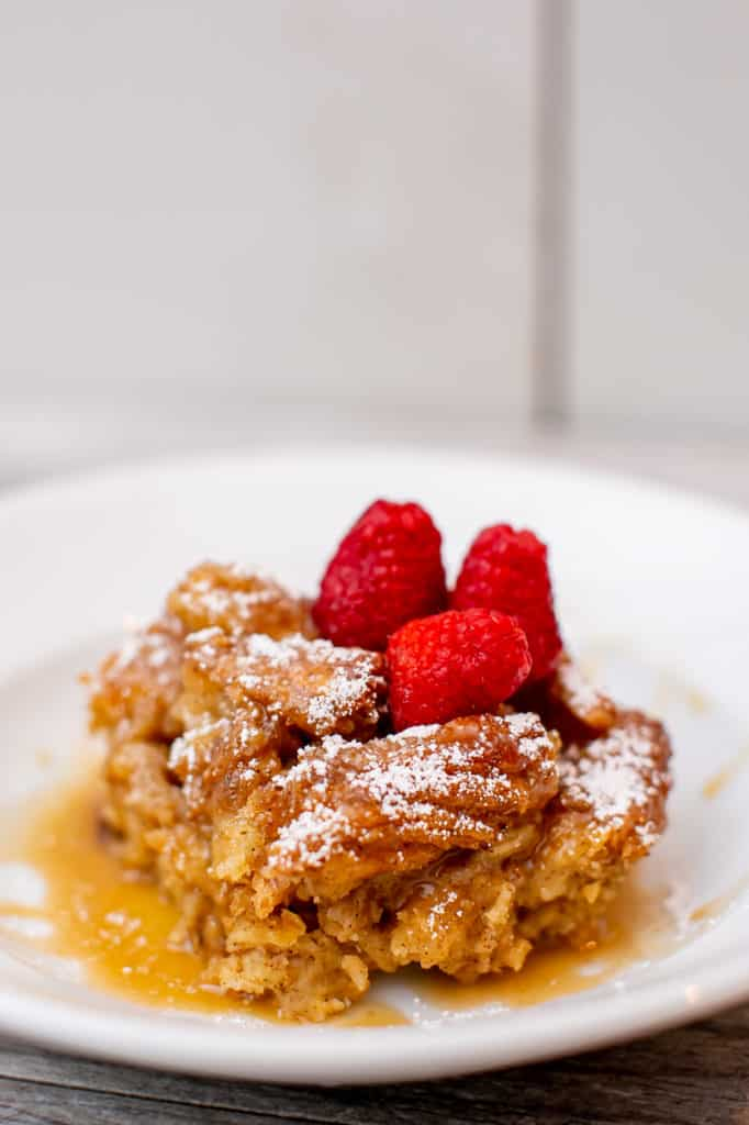 Churro bread pudding topped with raspberries