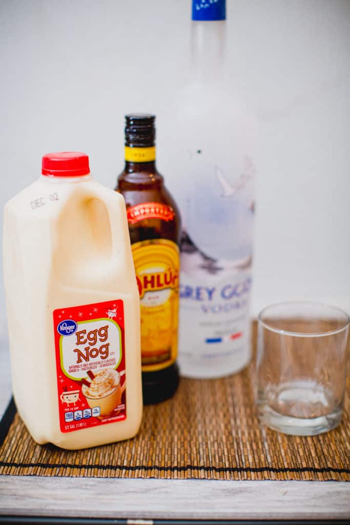 Ingredients for eggnog white Russian cocktail recipe set on a table mat