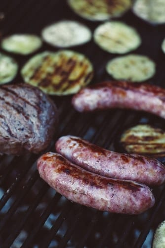 Slightly charred bratwursts after being cooked on a grill