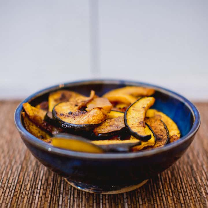 A bowl of baked spiced acorn squash