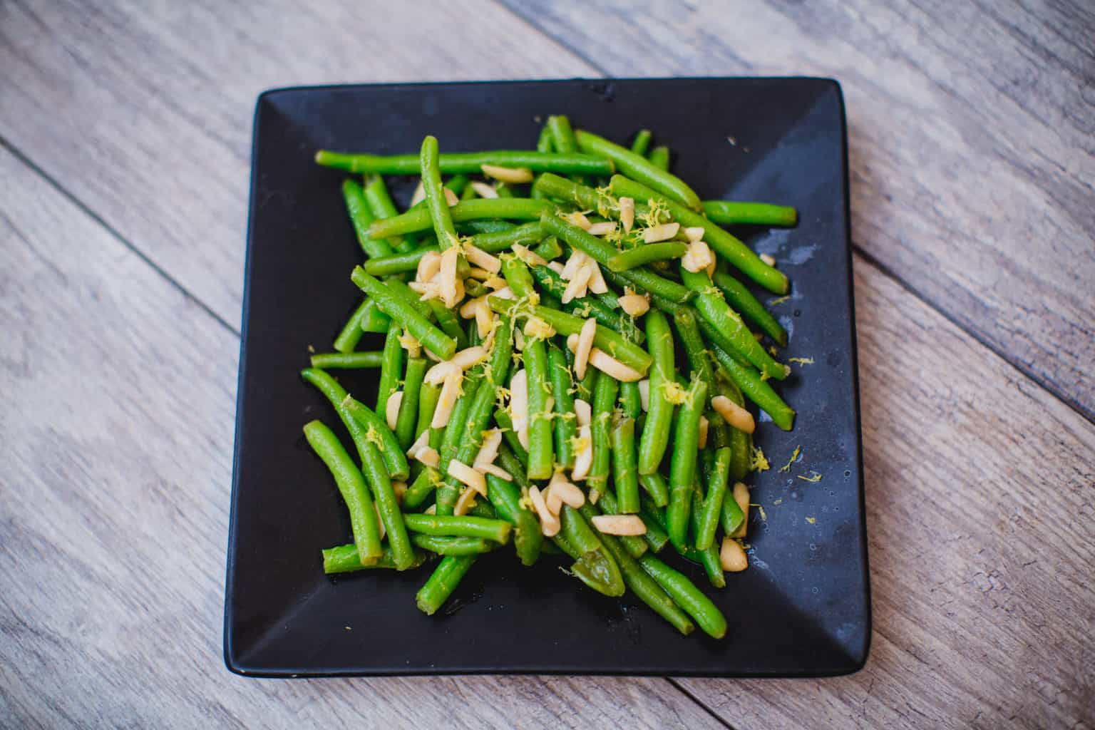 Simple green bean salad served on a plate