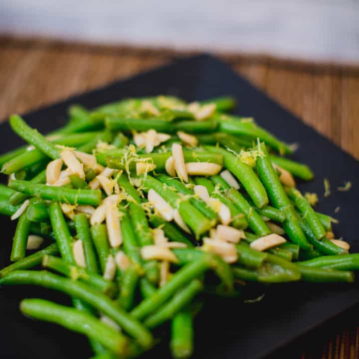 A close up of a simple green bean salad served on a plate