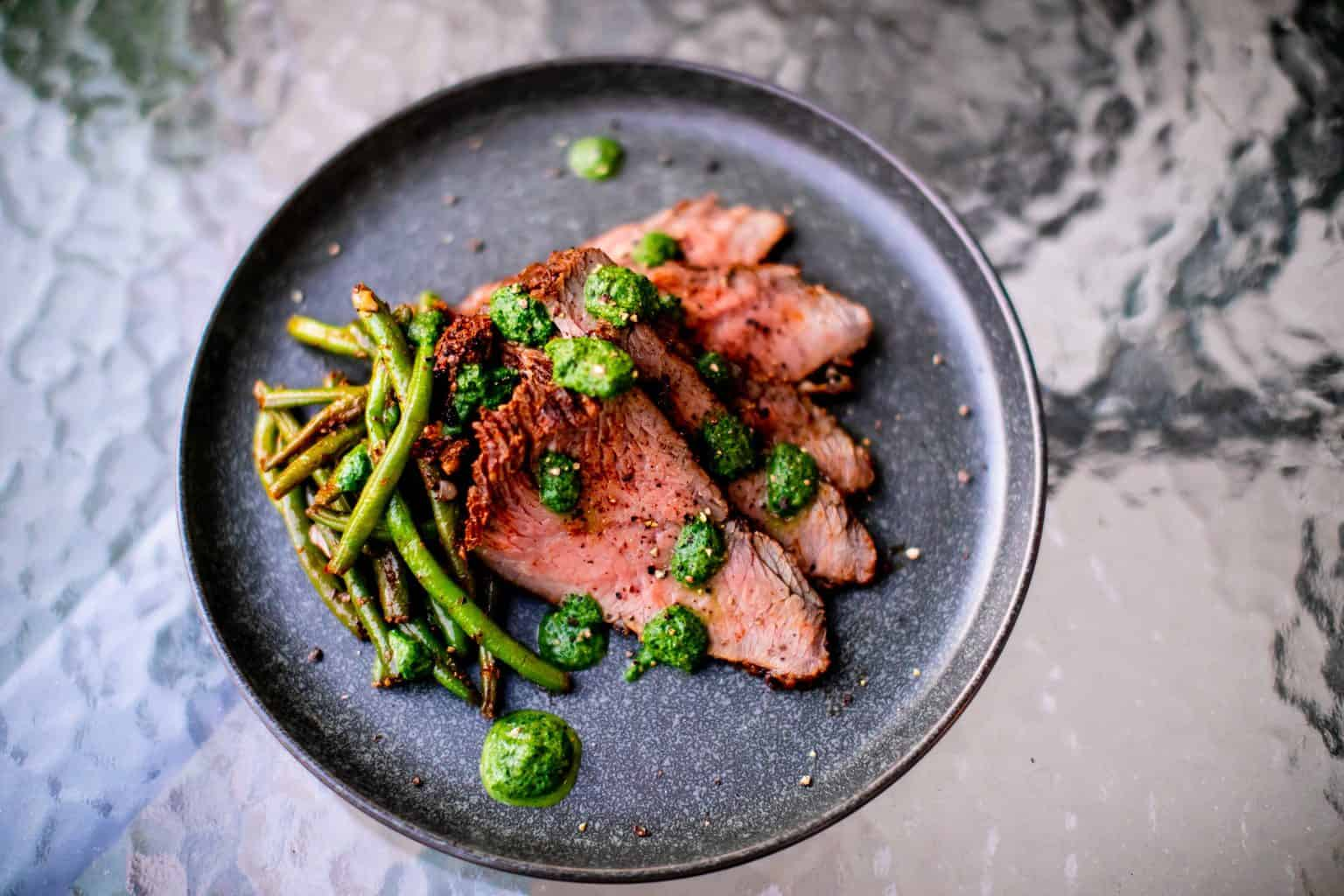 Finished sous vide tri tip recipe with vegetables on a plate