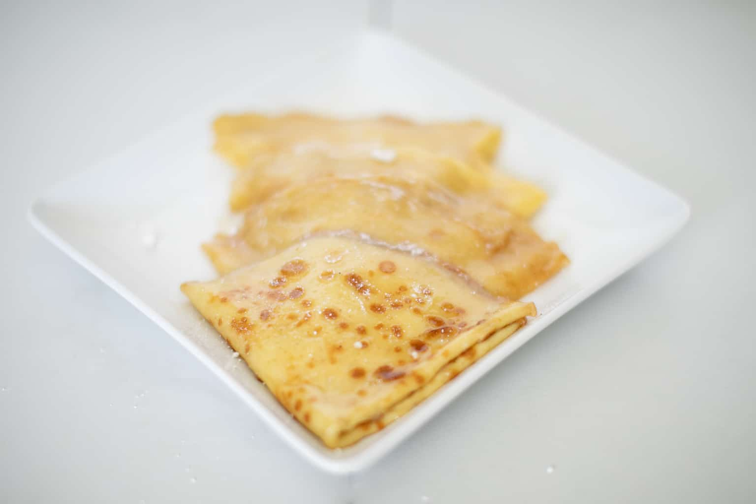Prepared simple classic crepes suzette recipe in a plate