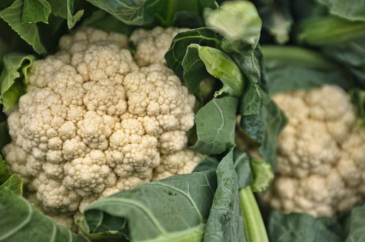 Fresh cauliflower in need of cleaning
