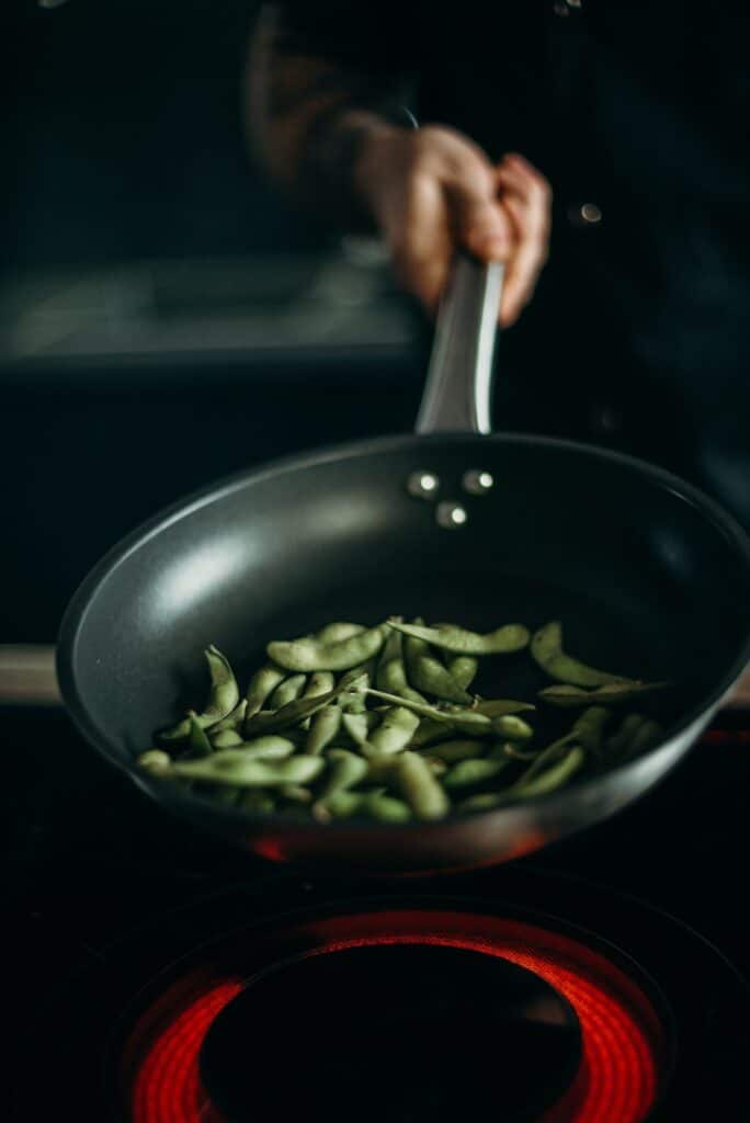 Green beans being cooked in a pan