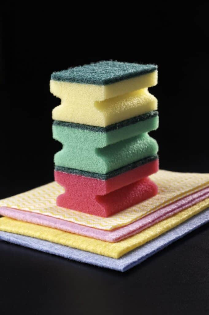 Sponge stacked on top of each other to be used to clean wooden salad bowls
