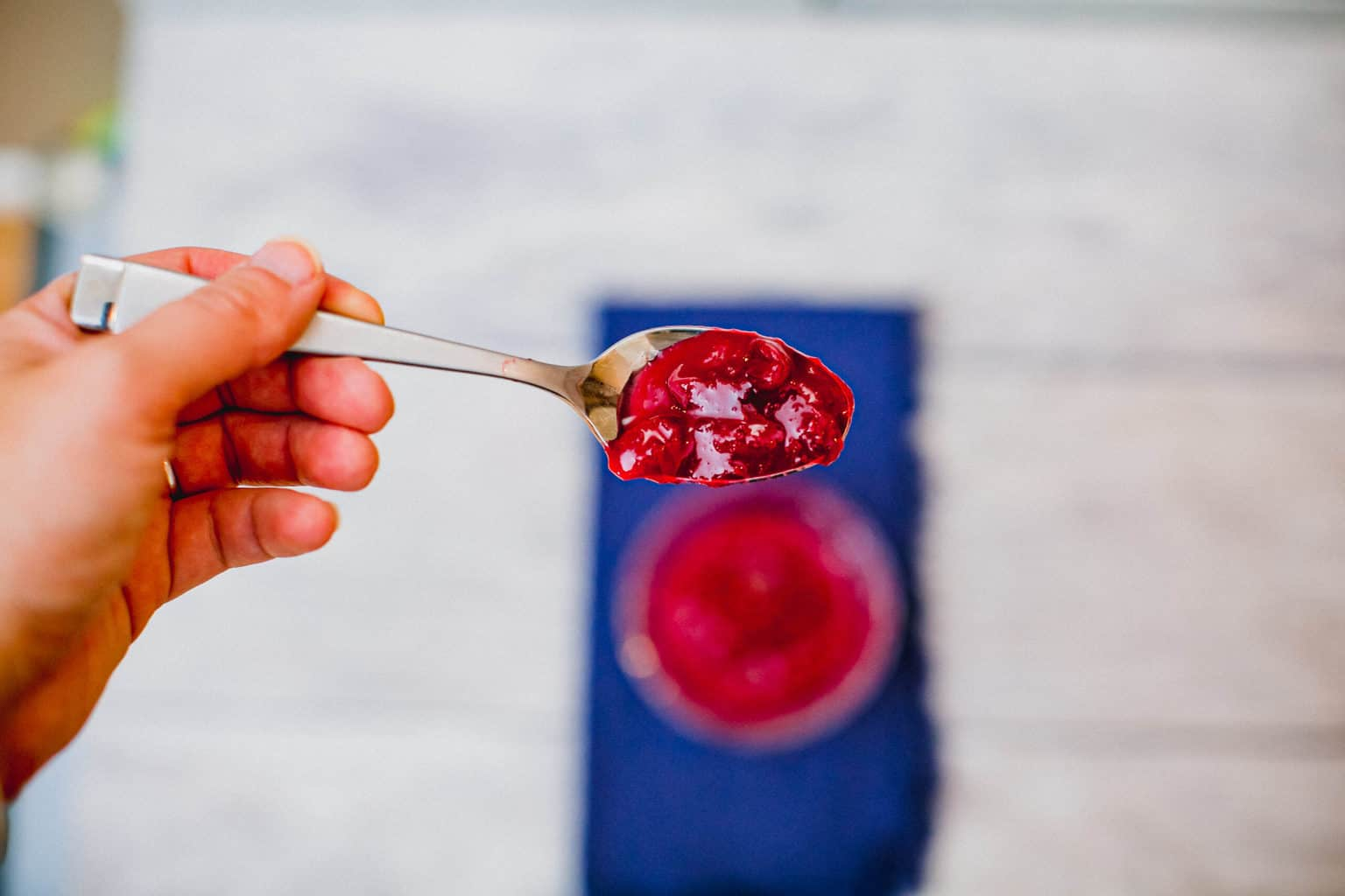 Cranberry sauce on a spoon