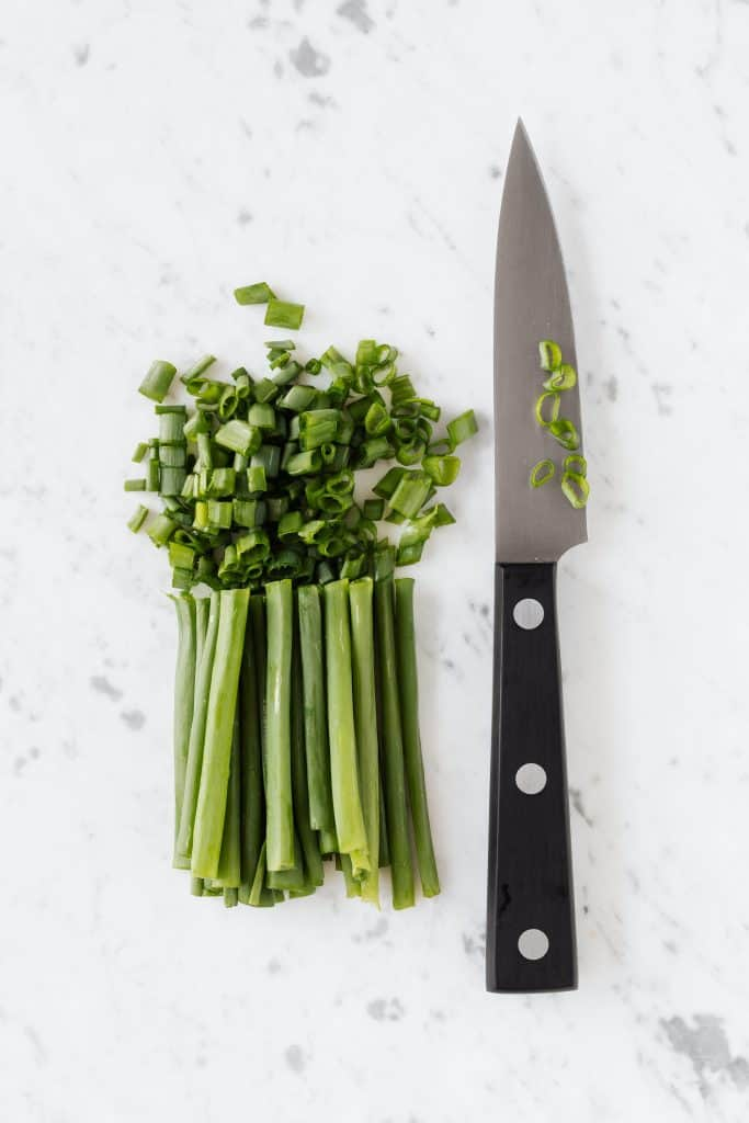 Green onions freshly cut by a sharp knife