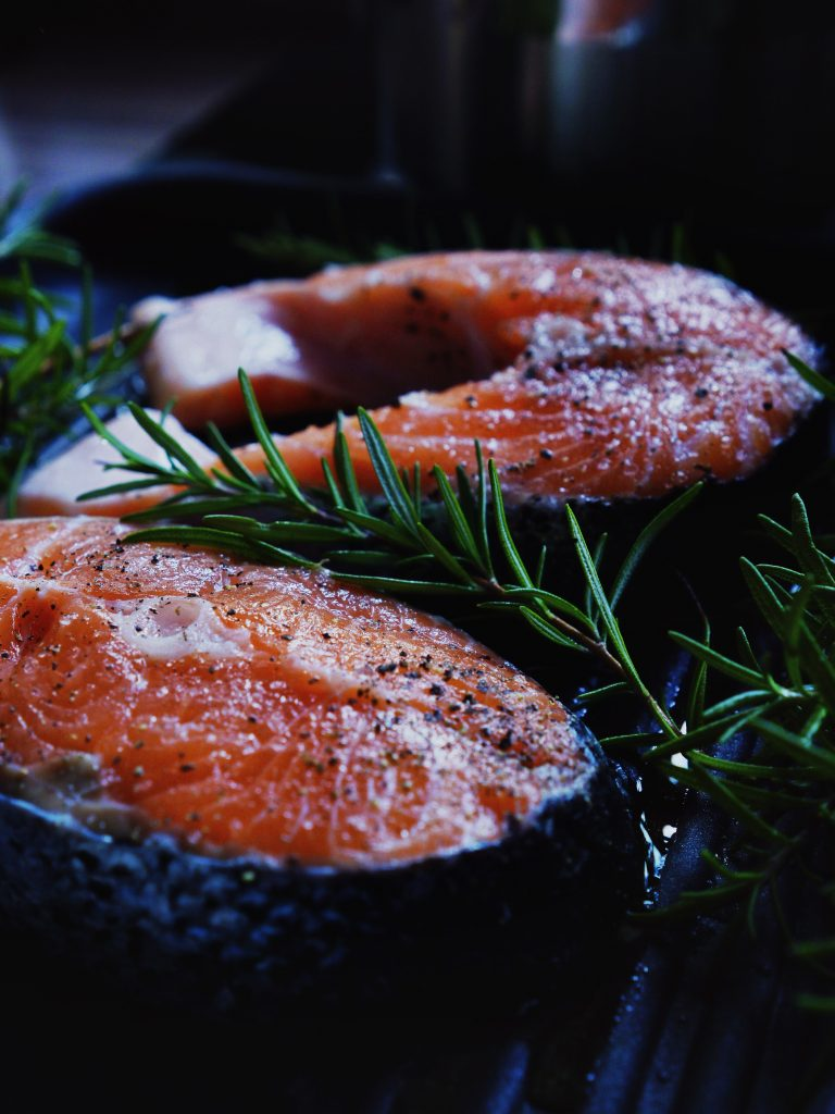 close up shot of fish with herbs