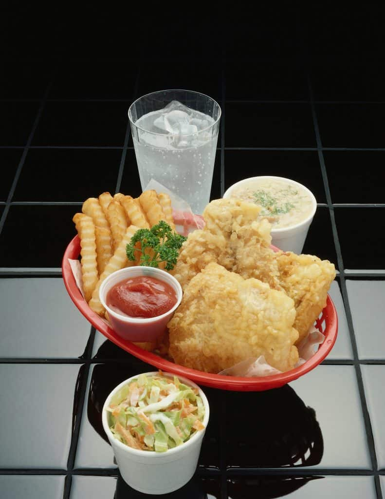Fish and chips with coleslaw and drinks