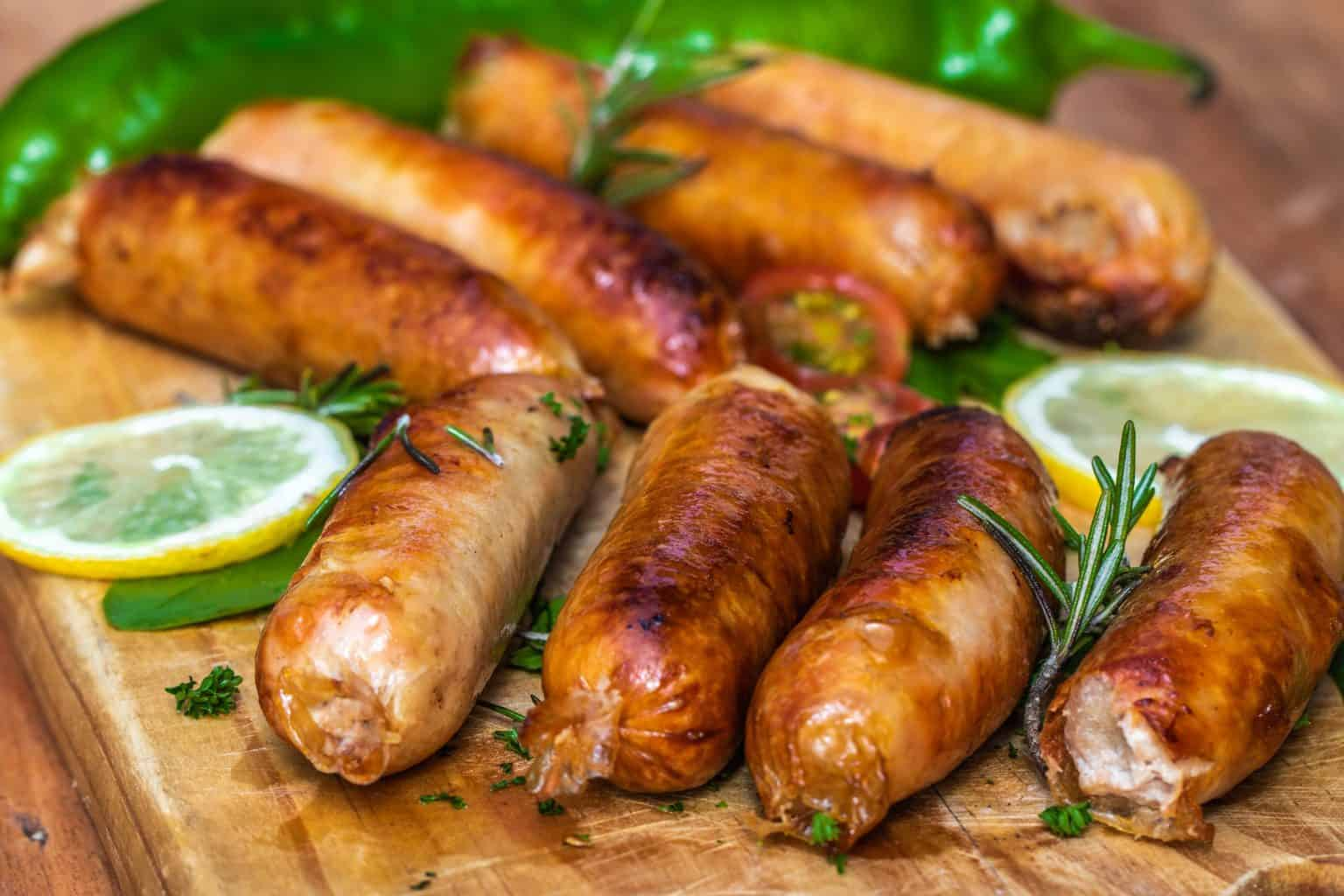 Sausages with seasoning ang leaves being served