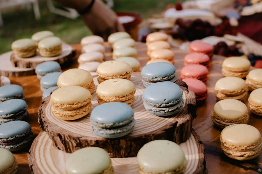 Freshly baked macarons placed on a table