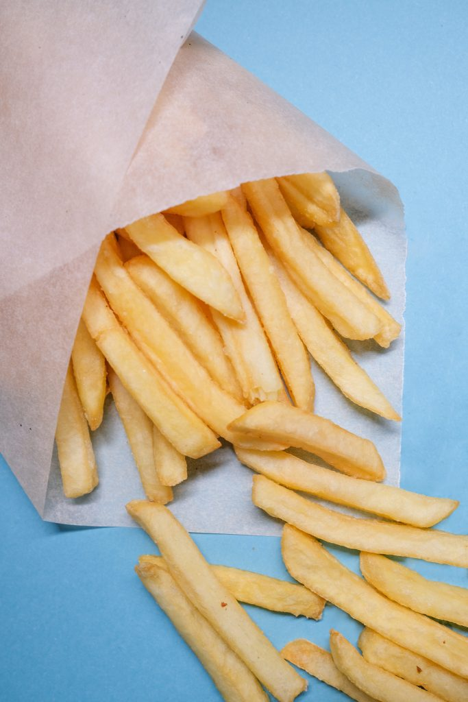 French fries wrapped in paper wax