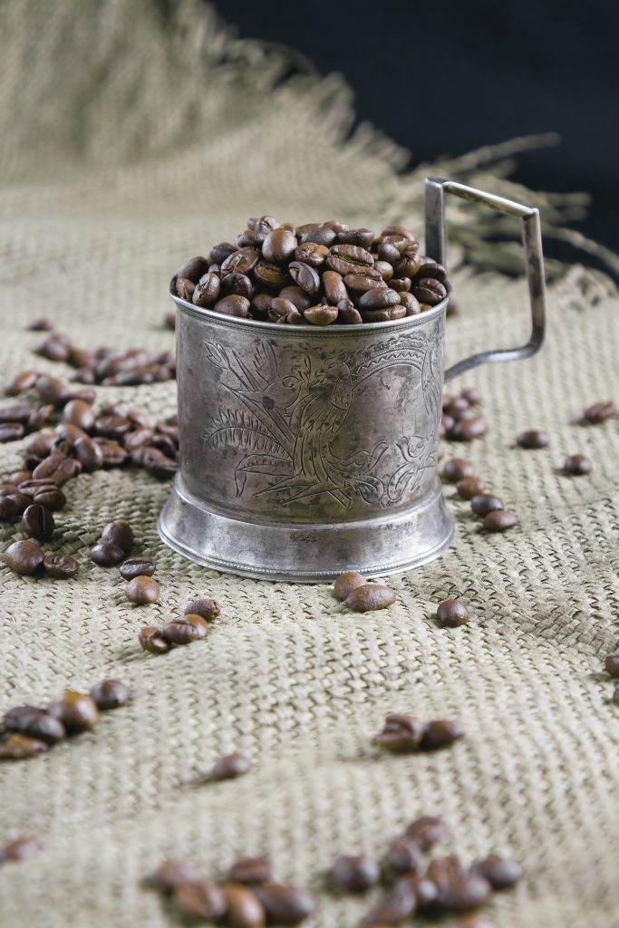 Coffee beans in a metal cup