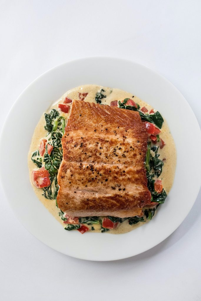A salmon meal drenched on creamy milk