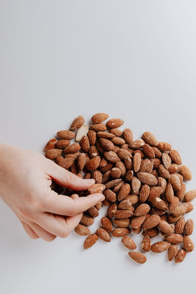 Almonds on a white table