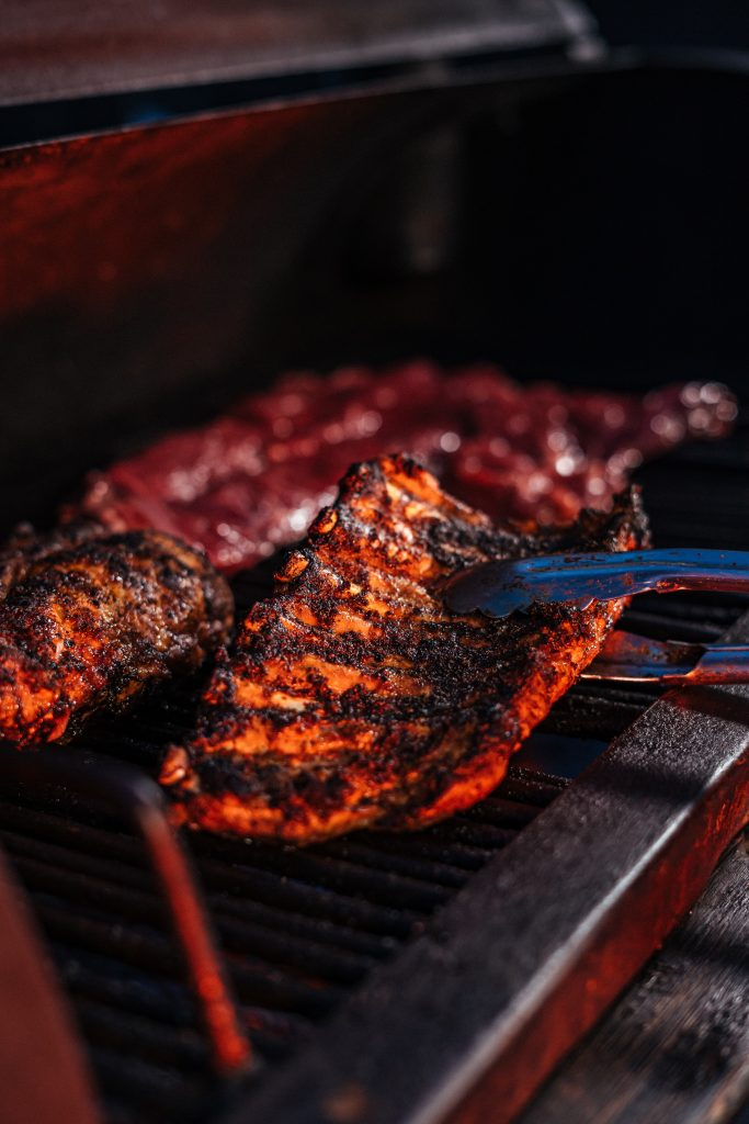 Ribs grilled handled with a tong