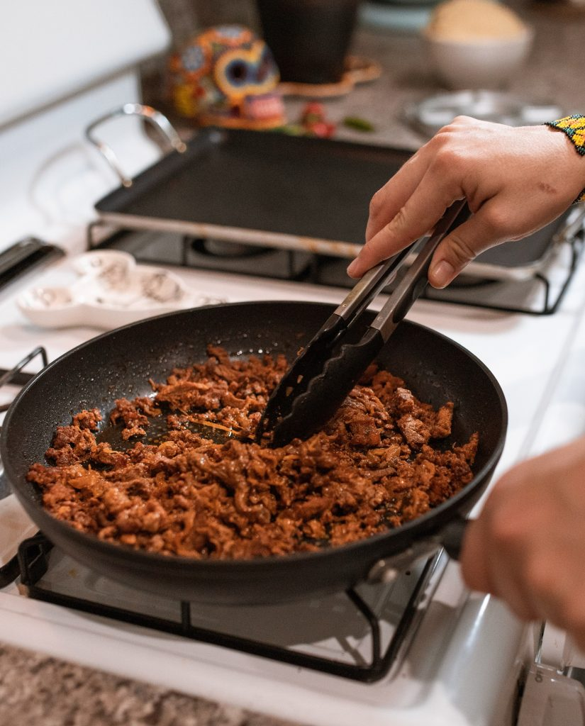 Cooking carne molida on a stove